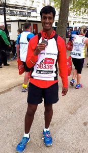 DLS London Marathon runner showing off his medal post-race.